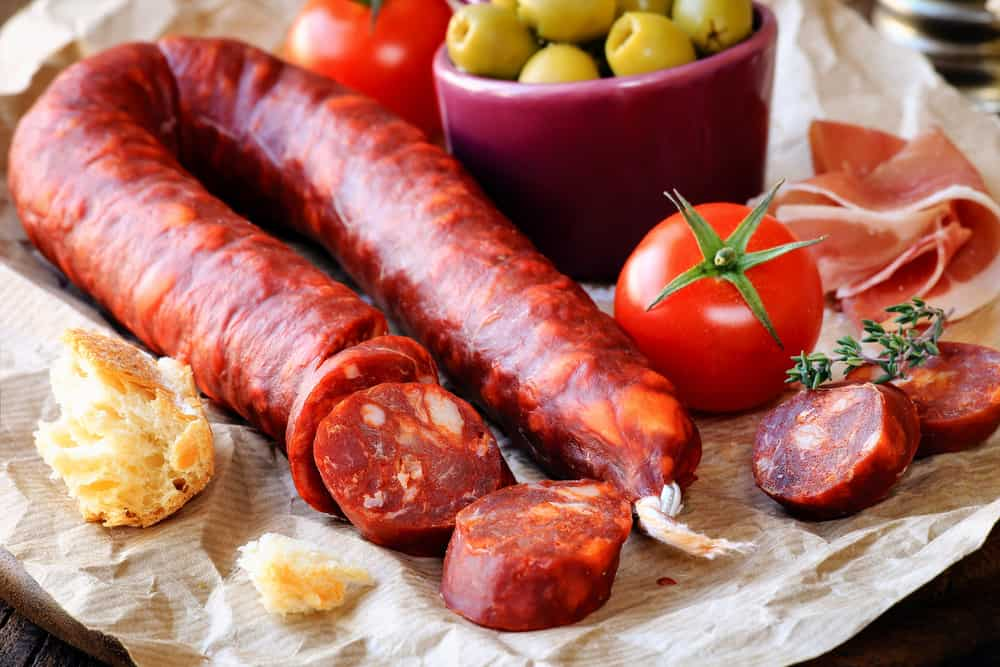Spanish chorizo link with olives and bread
