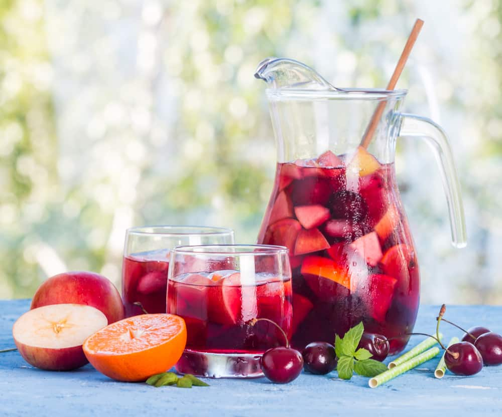 Pitchers of Spanish Sangria with two glasses of Sangria