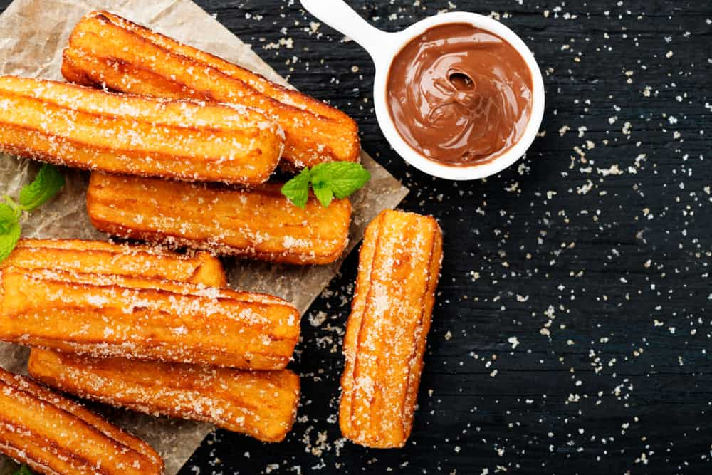 Churro pieces with chocolate sauce