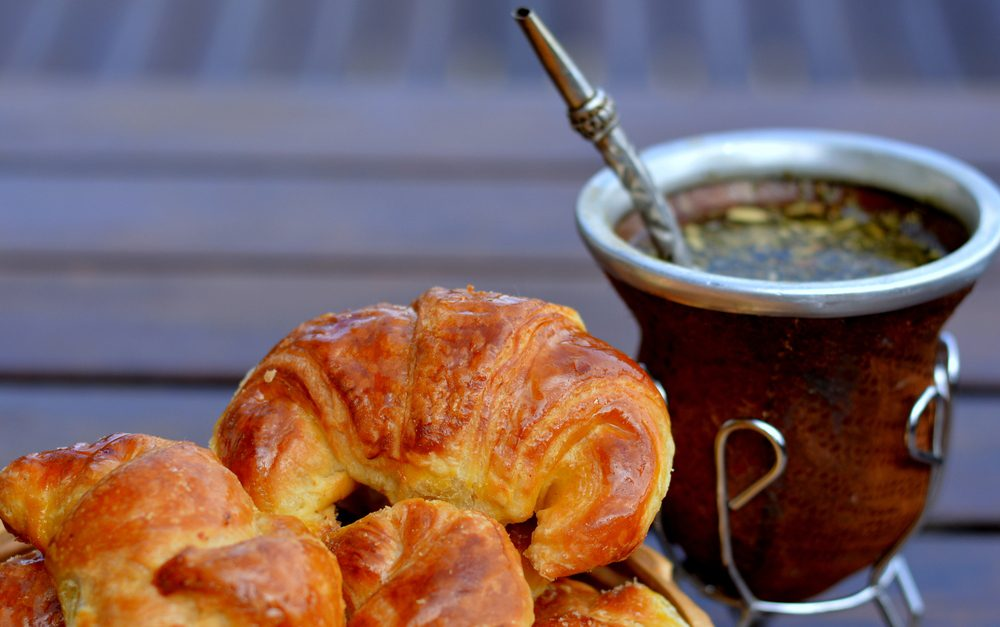 Medialuna pastry and yerba mate tea