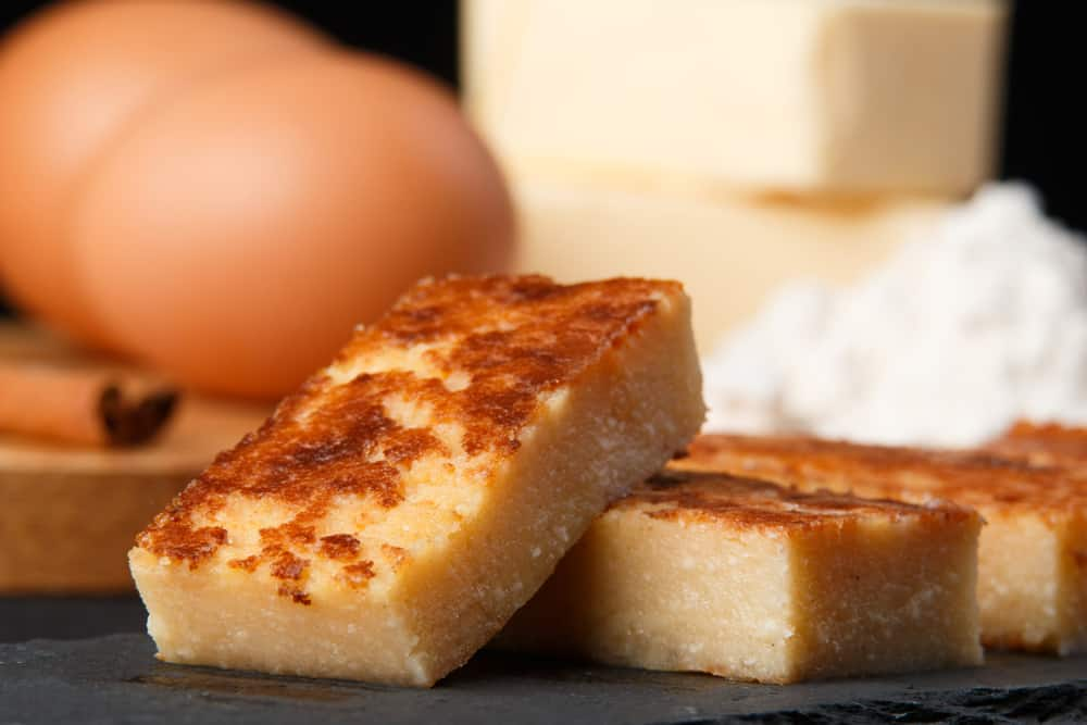 Pieces of Spanish dessert quesda pasiega eggs and butter