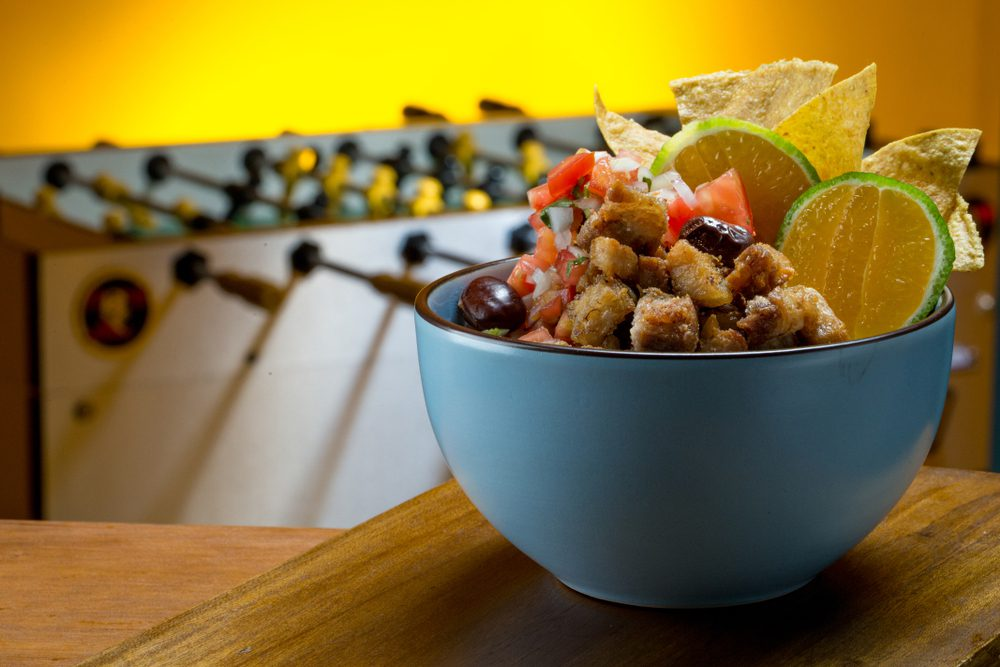 Bowl of Chifrijo on wooden table