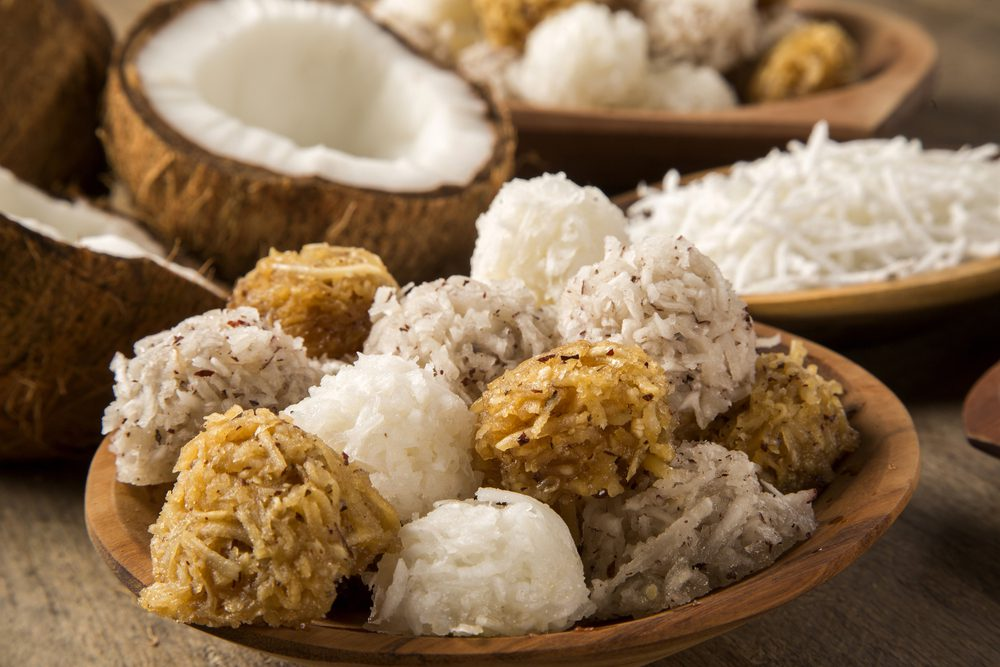 Colombian Coconut Cocadas Dessert with Open Coconut in the background