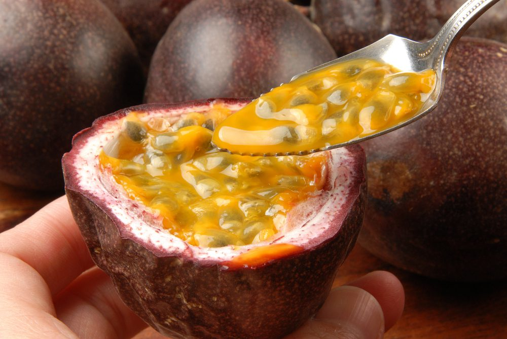 passion fruit pulp scooped out of the fruit with spoon