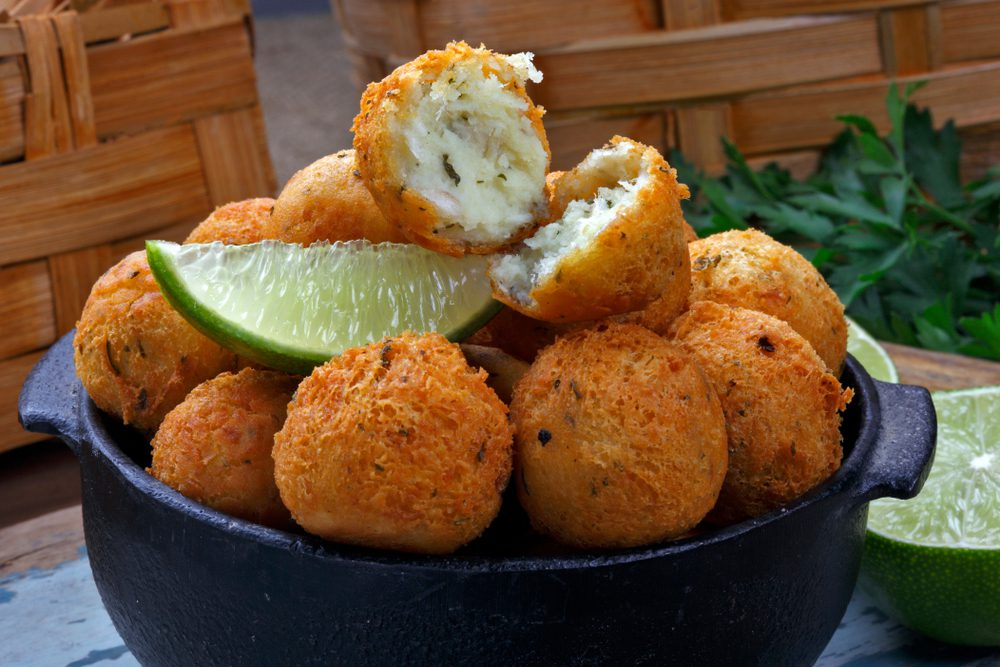 Brazilian Codfish Balls with lime in a bowl
