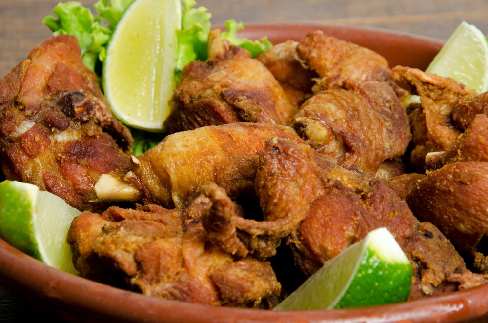 Brazil Fried Chicken in a bowl with lime