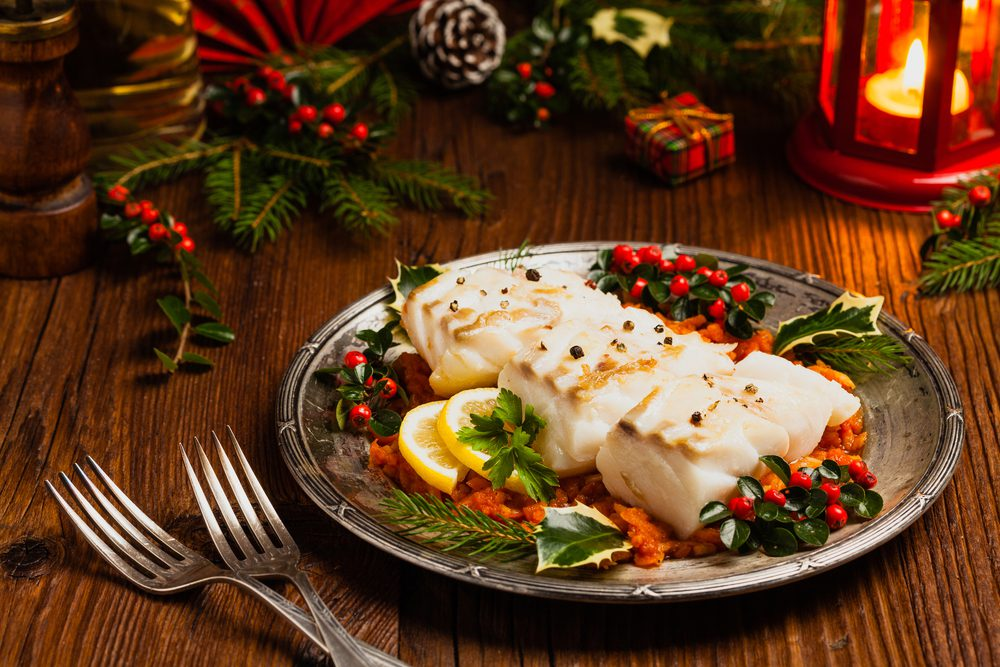 Brazilian Bacalhau Christmas Dinner served on plate on wooden table