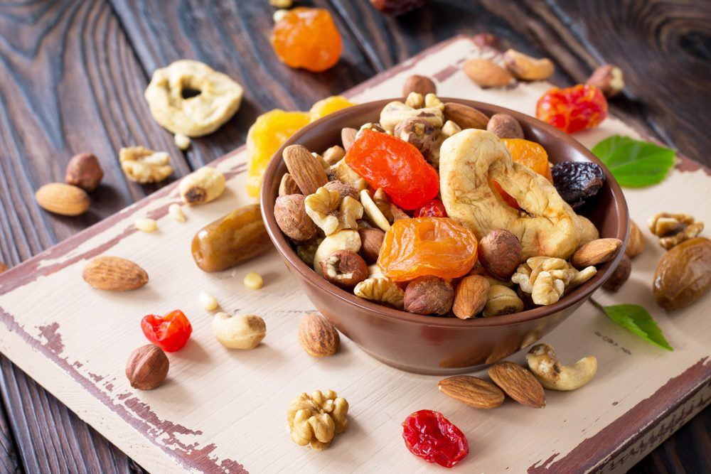 Brazilian Dried Fruits & Nuts scattered and in a bowl