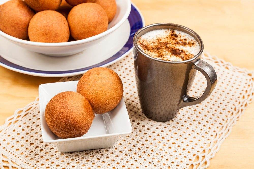 Colombian Bunuelos with hot chocolate on a table