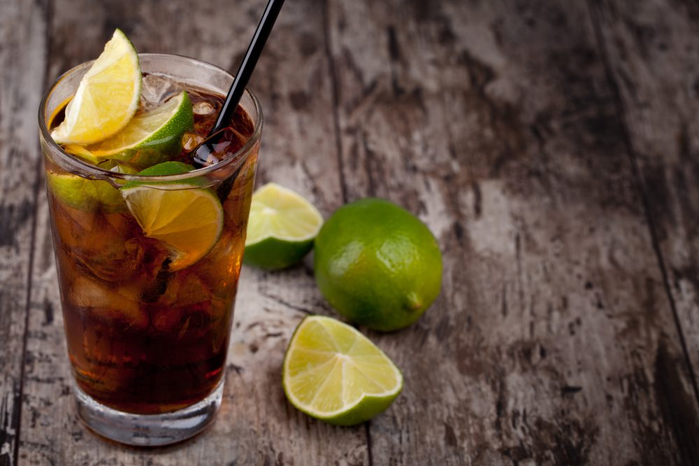 Cuban Cuba Libre and limes served on a table