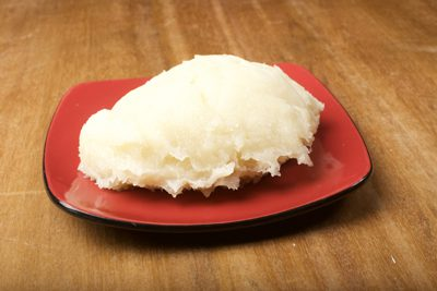 Fufu African Dish served on red plate on Woden table