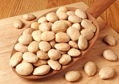 Marcona almonds in a wooden spoon