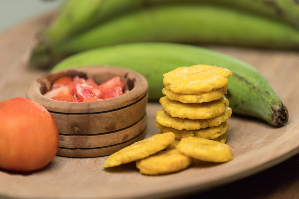 Patacones Colombian Side Dish with green plantain and sauce