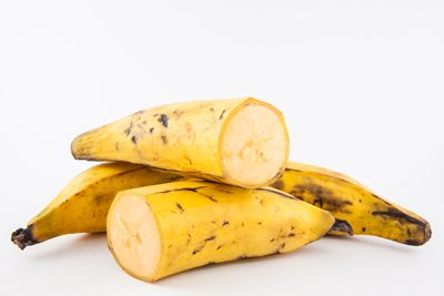 Sliced and whole ripe plantains