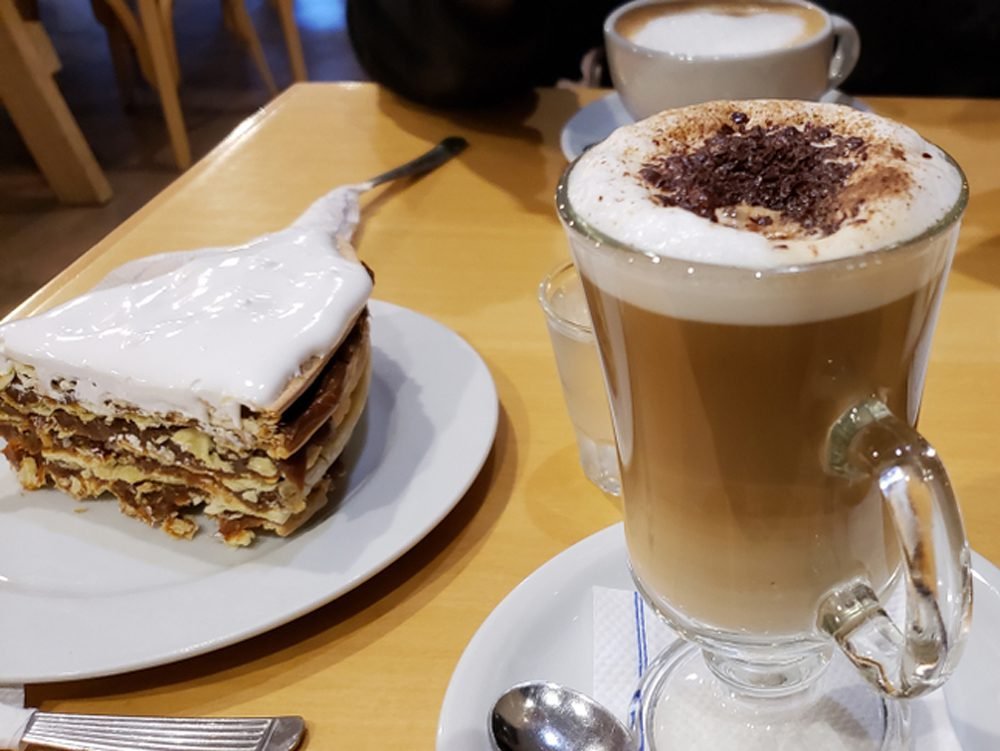 Torta Rogel served with Cappucino on wood table