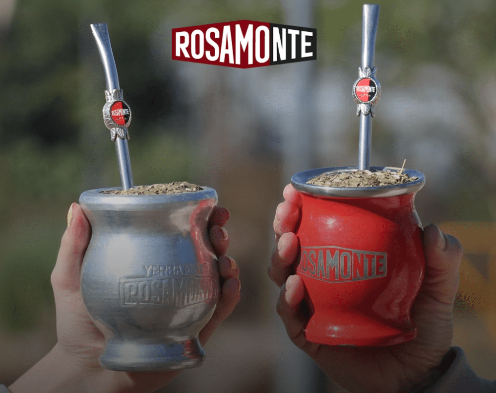 Two gourds of yerba mate cheering with bombillas