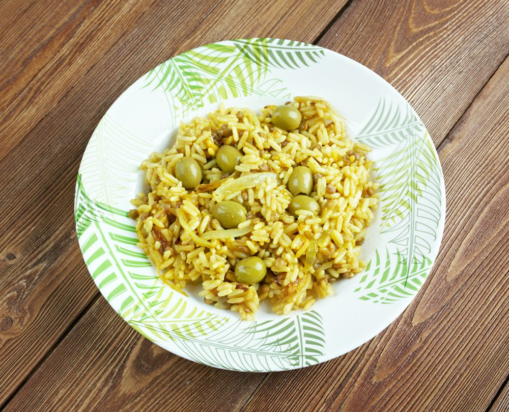 Plate of arroz con gandules on wooden table