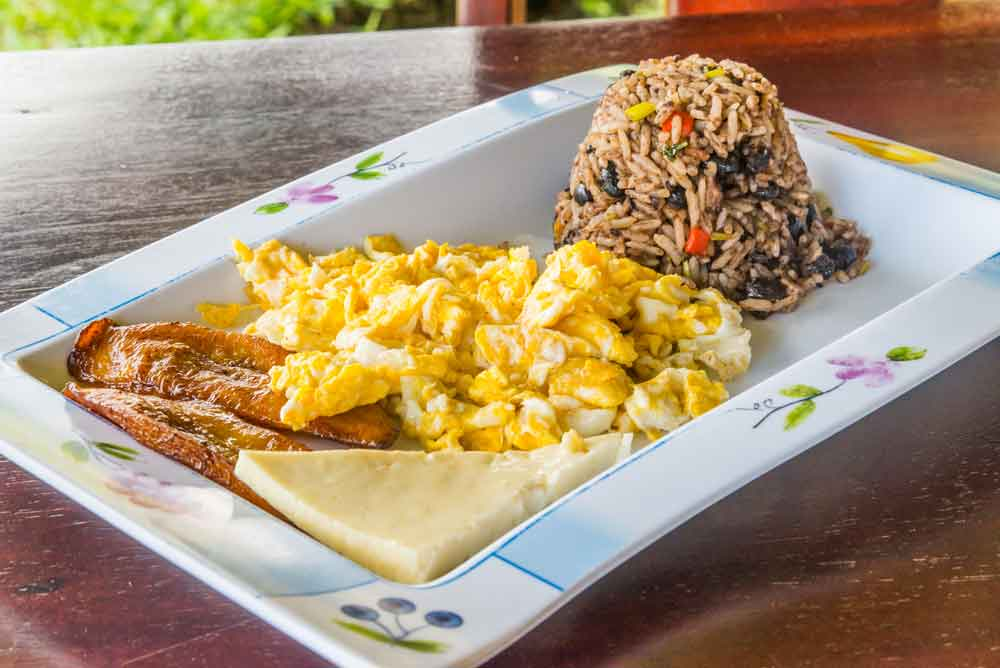 Nicaraguan National Dish, Gallo Pinto served with cheese, meat and eggs
