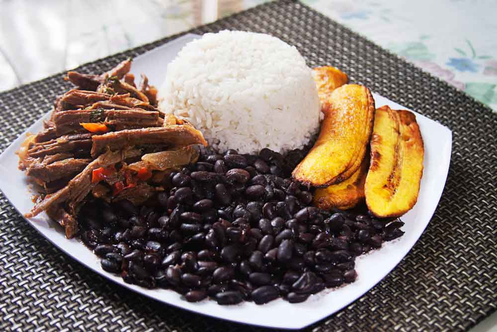 Venezuela's National Dish, Pabellon Crillo served on square white plate