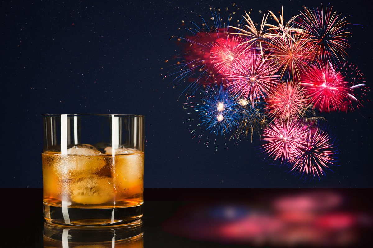 Latin Cocktail on table with fireworks background