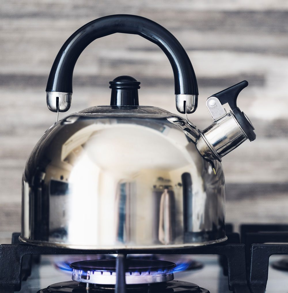 Metal Teapot on stove steaming